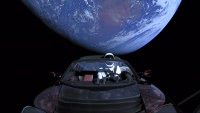 Tesla Roadster and Starman in front of Earth